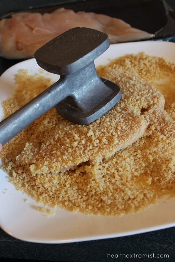 Using a meat tenderizer for paleo breadcrumbs on chicken breast