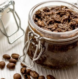 coffee scrub in jar with coffee beans